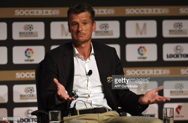 Former Dutch international footballer and comanager of Cruyff Football Wim Jonk speaks during a panel discussion at the Soccerex Global Convention...