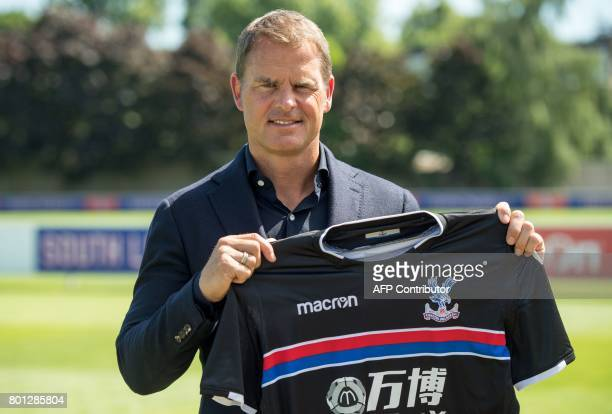 Former Dutch international great Frank de Boer poses as he is unveiled as the new manager of Crystal Palace Football Club in London on June 26 2017 /...