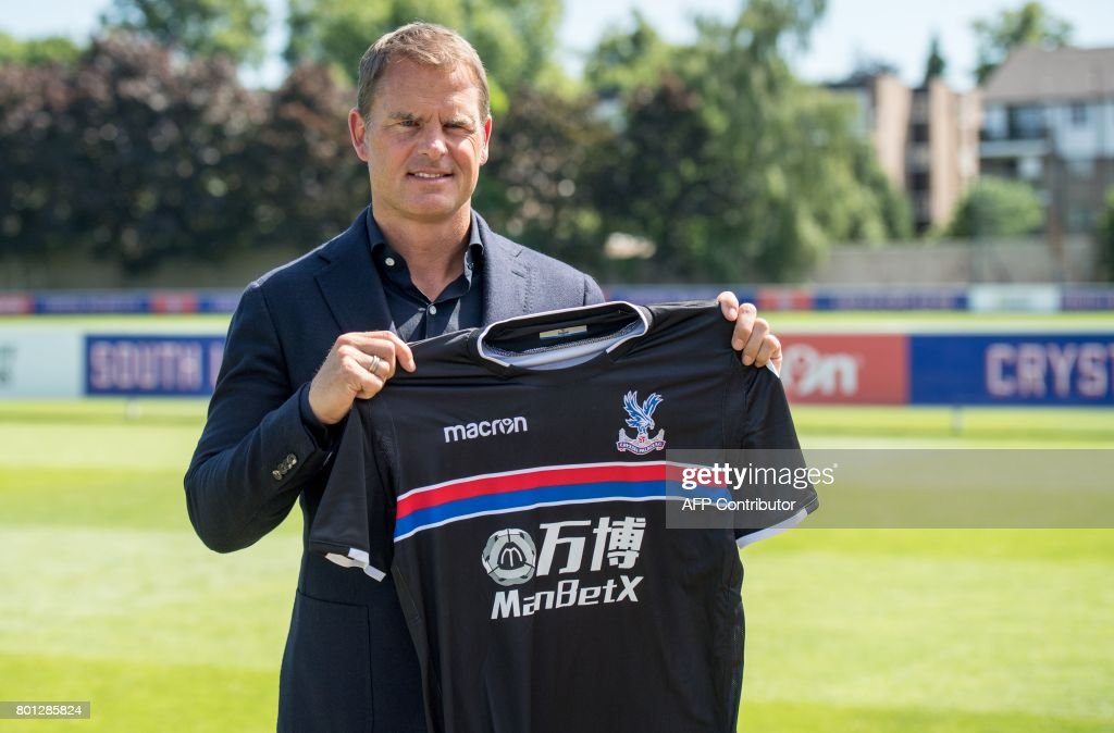 Former Dutch international great Frank de Boer poses as he is unveiled as the new manager of Crystal Palace Football Club in London on June 26, 2017. /