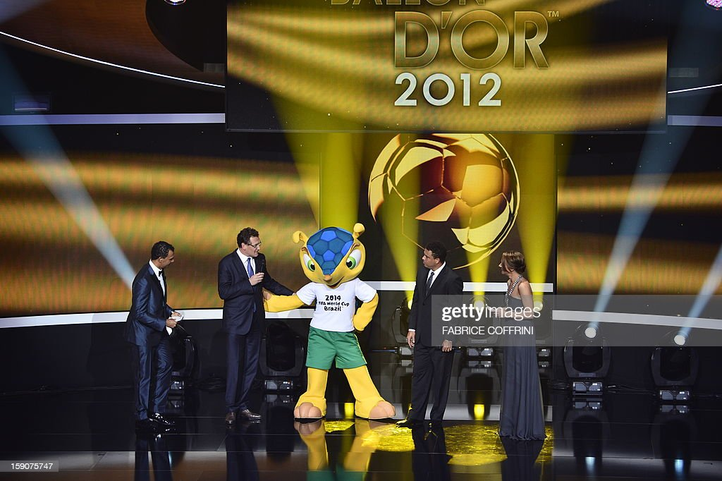 Former Dutch international Ruud Gullit, FIFA secretary general Jerome Valcke, Fuleco, the mascot for Brazil 2014 World cup, Brazilian former international Ronaldo and presenter Kay Murray take part in the FIFA Ballon d'Or awards ceremony at the Kongresshaus in Zurich on January 7, 2013.