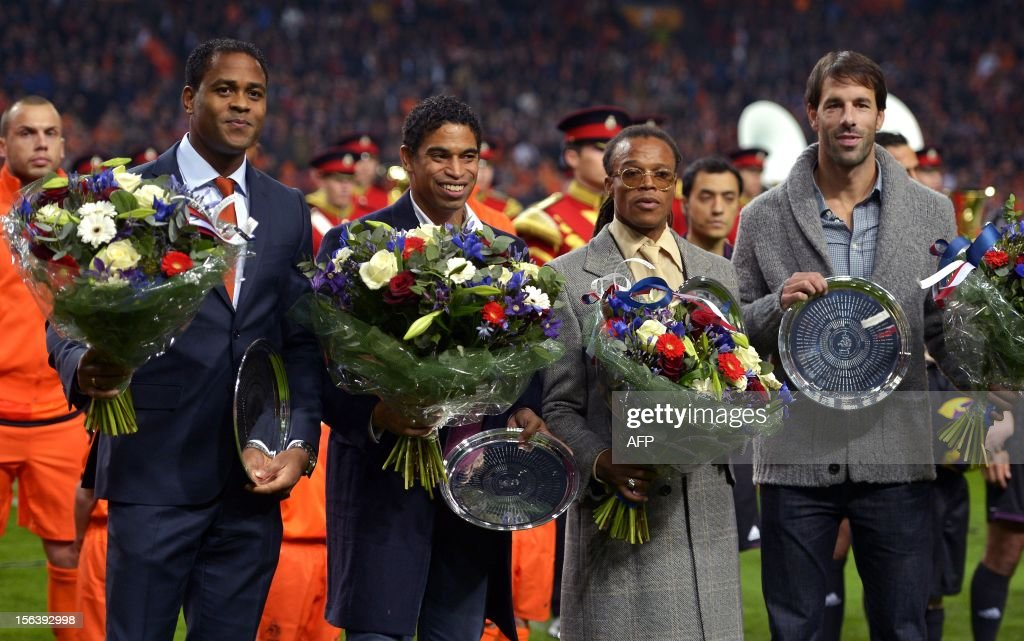 Former Dutch national football team players Patrick Kluivert, Michael Reiziger, Edgar Davids and Ruud van Nistelrooy stand during their farewell honoring ceremony on November 14, 2012, prior to the friendly football match between the Netherlands and Germany in Amsterdam. AFP PHOTO/ANP/ KOEN VAN WEEL netherlands out