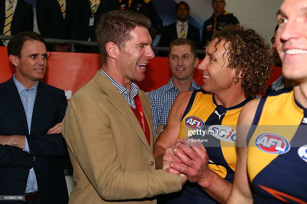 Former Eagles player Beau Waters talks with <a gi-track='captionPersonalityLinkClicked' href=/galleries/search?phrase=Matt+Priddis&family=editorial&specificpeople=4155904 ng-click='$event.stopPropagation()'>Matt Priddis</a> of the Eagles after the round 15 AFL match between the West Coast Eagles and the Essendon Bombers at Domain Stadium on June 30, 2016 in Perth, Australia.