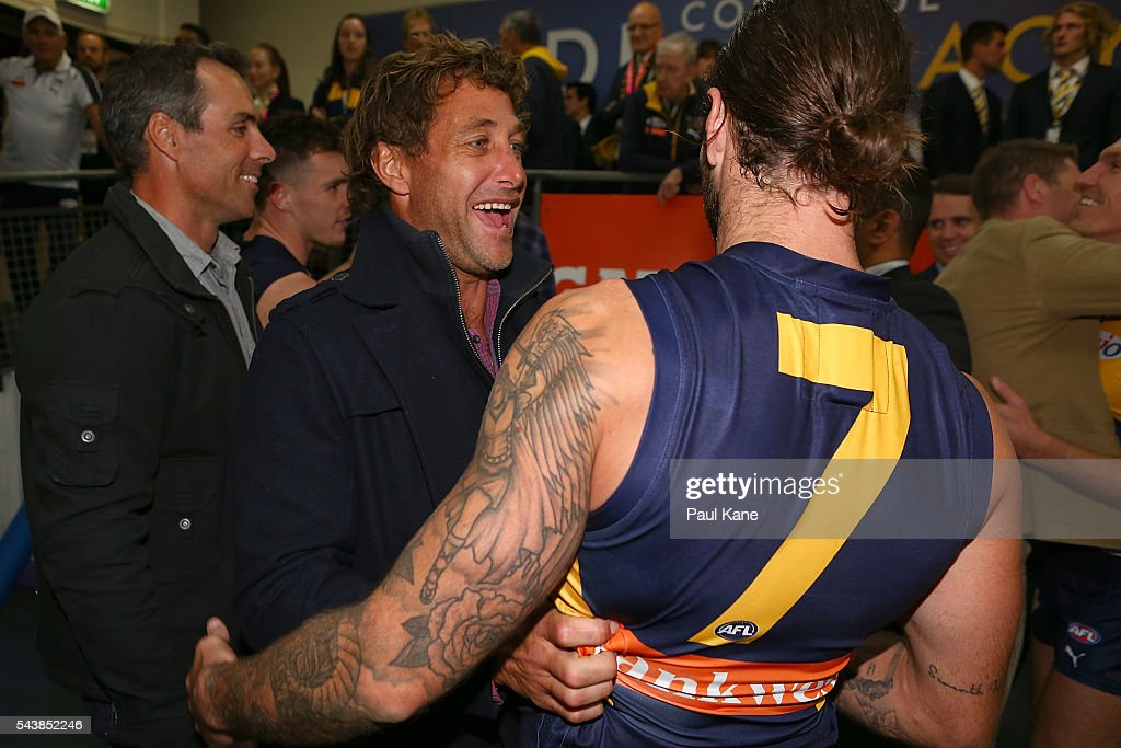 Former Eagles player Chad Fletcher talks with Chris Masten of the Eagles after the round 15 AFL match between the West Coast Eagles and the Essendon Bombers at Domain Stadium on June 30, 2016 in Perth, Australia.