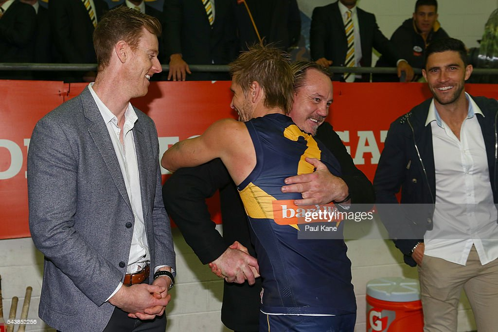 Former Eagles player Daniel Chick is embraced by Mark LeCras of the Eagles after the round 15 AFL match between the West Coast Eagles and the Essendon Bombers at Domain Stadium on June 30, 2016 in Perth, Australia.
