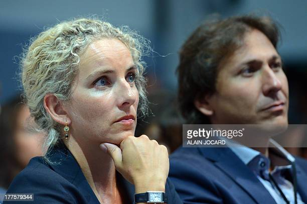 Former Ecology minister Delphine Batho listens to a speech during a plenary session on the second day of the 'Universites d'ete' the PS summer...