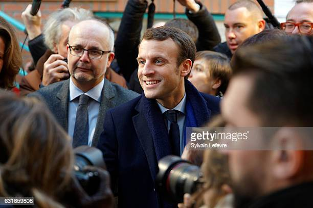 Former Economy Minister Emmanuel Macron visits an infant school during his campaign for next presidential elections on January 14 2017 in Lille...