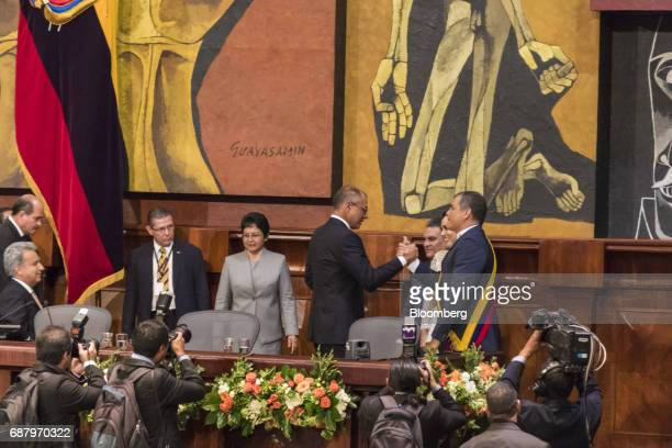 Former Ecuadorian president Rafael Correa right greets Jorge Glas Ecuador's vice president second right during the presidential inauguration Lenin...