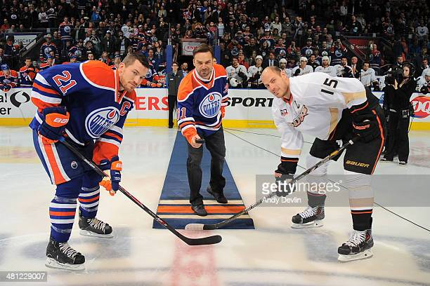 Former Edmonton Oilers goaltender Curtis Joseph performs the ceremonial puck drop prior to a game between the Edmonton Oilers and the Anaheim Ducks...
