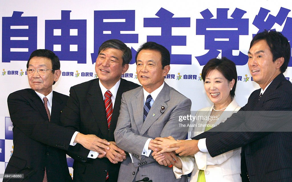 Former Education, Culture, Sports, Science and Technology Minister <a gi-track='captionPersonalityLinkClicked' href=/galleries/search?phrase=Kaoru+Yosano&family=editorial&specificpeople=570121 ng-click='$event.stopPropagation()'>Kaoru Yosano</a>, Former Defense Minister <a gi-track='captionPersonalityLinkClicked' href=/galleries/search?phrase=Shigeru+Ishiba&family=editorial&specificpeople=2921096 ng-click='$event.stopPropagation()'>Shigeru Ishiba</a>, Former Foreign Minister <a gi-track='captionPersonalityLinkClicked' href=/galleries/search?phrase=Taro+Aso&family=editorial&specificpeople=559212 ng-click='$event.stopPropagation()'>Taro Aso</a>, Former Defense Minister <a gi-track='captionPersonalityLinkClicked' href=/galleries/search?phrase=Yuriko+Koike&family=editorial&specificpeople=588171 ng-click='$event.stopPropagation()'>Yuriko Koike</a> and Former land, infrastructure and transportation Minister <a gi-track='captionPersonalityLinkClicked' href=/galleries/search?phrase=Nobuteru+Ishihara&family=editorial&specificpeople=2258645 ng-click='$event.stopPropagation()'>Nobuteru Ishihara</a> join hands at joint press conference on LDP's presidential election campaign at Liberal Democratic Party (LDP) headquarter on September 10, 2008 in Tokyo, Japan.