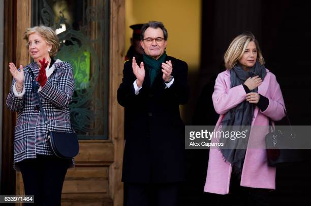 Former Education Minister Irene Rigau former Catalan President Artur Mas and former Vicepresident Joana Ortega applaud to the crowd as they arrive to...
