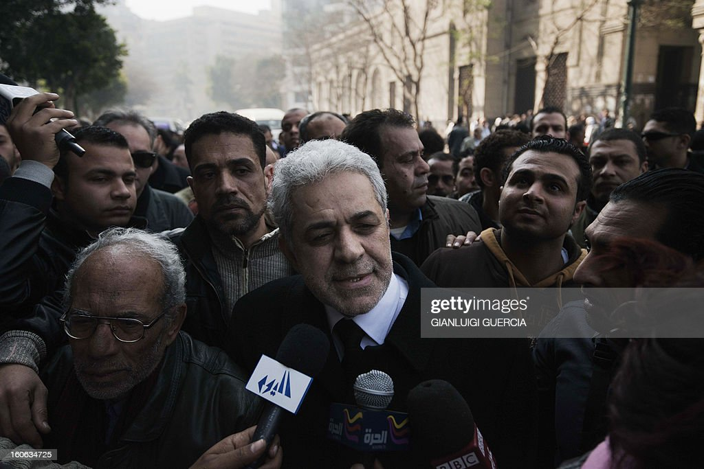 Former Egyptian president candidate Hamdeen Sabahi (C) talks to the media after attending the funeral of killed Egyptian activists Amro Saad and Mohammed al-Guindi outside Omar Makram Mosque in Cairo's Tahrir Square on February 4, 2013. Saad died in clashes during anti-government protests on February 1, while Guindi, 28, went missing last month after joining protests demanding change on the second anniversary of Egypt's uprising against former president Hosni Mubarak and then slipped into a coma following days in police custody, according to the health ministry and his party.