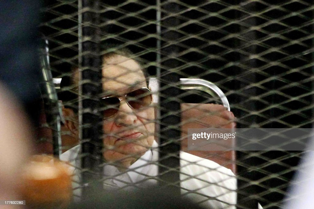Former Egyptian president Hosni Mubarak is seen behind bars during his retrial on August, 25 2013 in Cairo. An Egyptian court on Sunday adjourned the murder and corruption retrial of former strongman Hosni Mubarak, his sons and security commanders to September 14. Mubarak, who was freed from prison and placed under house arrest earlier in the week, attended the retrial, along with the other defendants. AFP PHOTO/STR
