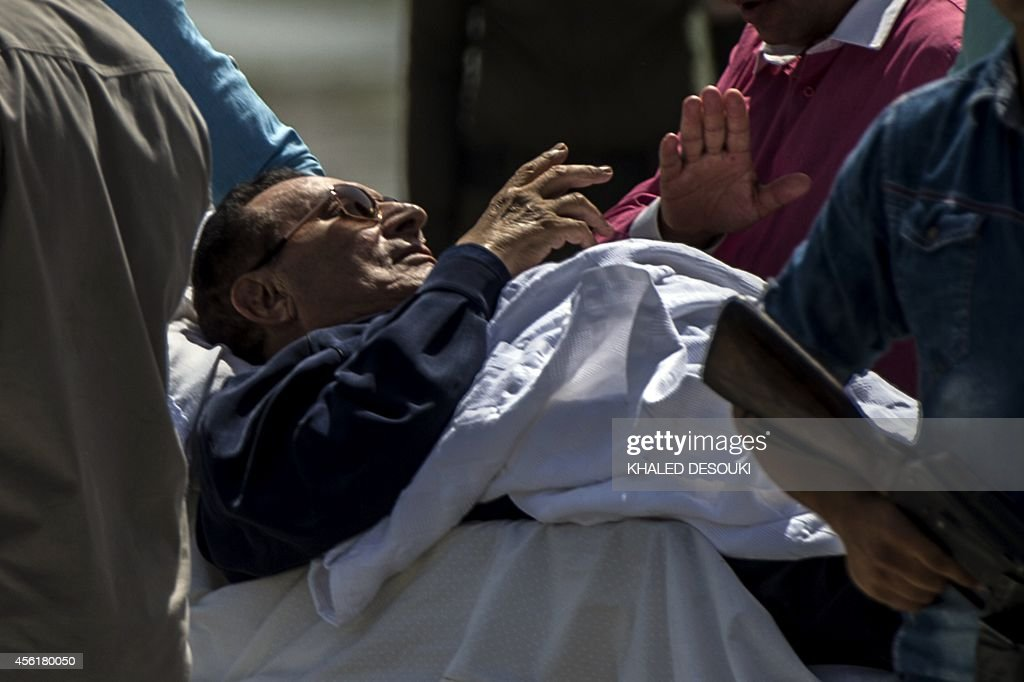 Former Egyptian president <a gi-track='captionPersonalityLinkClicked' href=/galleries/search?phrase=Hosni+Mubarak&family=editorial&specificpeople=201752 ng-click='$event.stopPropagation()'>Hosni Mubarak</a> is wheeled out of a helicopter into an ambulance outside the Maadi military hospital in Cairo on September 27, 2014 after returning from the court. An Egyptian court postponed its verdict in the murder retrial of former president <a gi-track='captionPersonalityLinkClicked' href=/galleries/search?phrase=Hosni+Mubarak&family=editorial&specificpeople=201752 ng-click='$event.stopPropagation()'>Hosni Mubarak</a> to November, in the latest twist in the legal battle surrounding the ousted autocrat.
