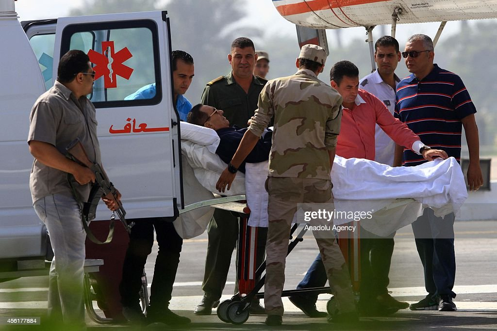 Former Egyptian president <a gi-track='captionPersonalityLinkClicked' href=/galleries/search?phrase=Hosni+Mubarak&family=editorial&specificpeople=201752 ng-click='$event.stopPropagation()'>Hosni Mubarak</a> is wheeled out of an ambulance outside the Maadi military hospital in Cairo on September 27, 2014 before boarding a helicopter that transports him to a court. An Egyptian court adjourned until November 29 the verdict in the trial of former president <a gi-track='captionPersonalityLinkClicked' href=/galleries/search?phrase=Hosni+Mubarak&family=editorial&specificpeople=201752 ng-click='$event.stopPropagation()'>Hosni Mubarak</a> on charges of ordering the killing of anti-regime protesters.