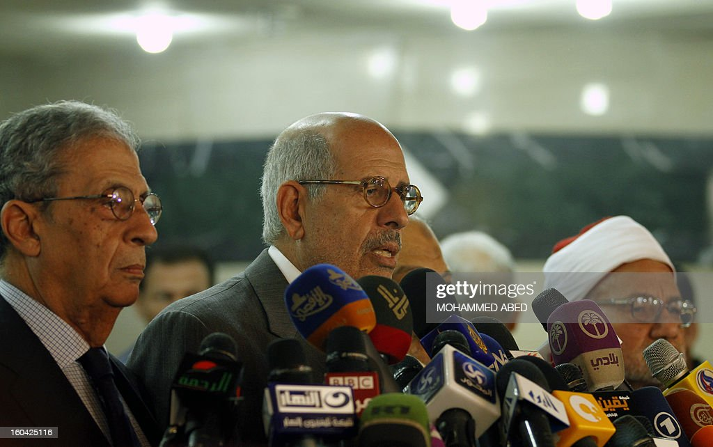 Former Egyptian presidential candidate Amr Moussa (L), Egyptian opposition leader and Nobel Prize Laureate Mohammed el-Baradei (2L) and a representative of the Azhar scholars Nasr Wassel (R) give a press conference in Cairo on January 31, 2013. Rival factions in Egypt condemned the violence which has killed dozens in a week of unrest and pledged support for a national dialogue to resolve the political crisis gripping the country. AFP PHOTO/MOHAMMED ABED