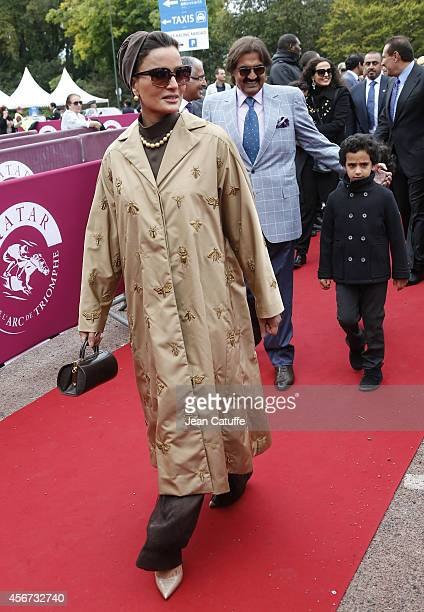 Former Emir of Qatar Sheikh Hamad ben Khalifa alThani and his wife Sheikha Mozah bint Nasser Al Missned attend the Qatar Prix de I'Arc de Triomphe at...