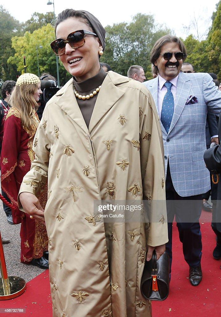 Former Emir of Qatar Sheikh Hamad ben Khalifa al-Thani and his wife Sheikha Mozah bint Nasser Al Missned attend the Qatar Prix de I'Arc de Triomphe at Longchamp racecourse on October 5, 2014 in Paris, France.