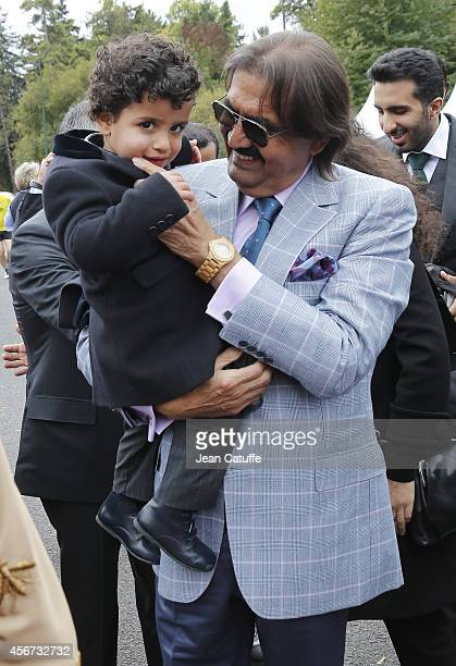Former Emir of Qatar Sheikh Hamad ben Khalifa alThani and one of his grandson attend the Qatar Prix de I'Arc de Triomphe at Longchamp racecourse on...