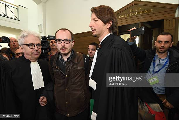 Former employee at services firm PwC Antoine Deltour and his lawyers Philippe Penning and William Bourdon leave the courthouse in Luxembourg on April...