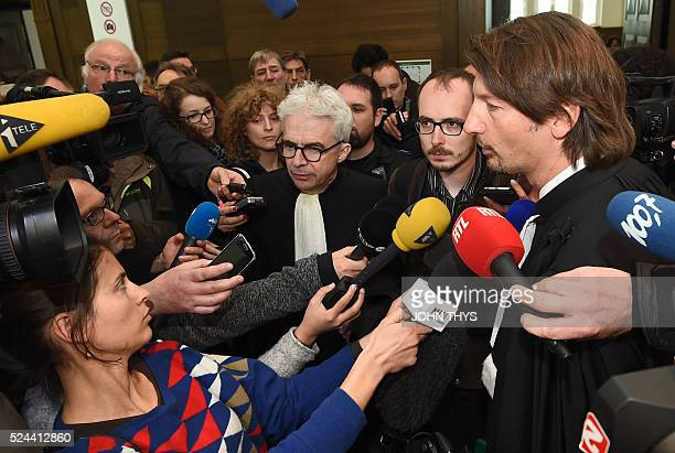 Former employee at services firm PwC Antoine Deltour and his lawyers Philippe Penning and William Bourdon address the media at the courthouse in...