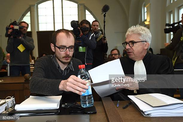 Former employee at services firm PwC Antoine Deltour speaks with his lawyer William Bourdon at the courthouse in Luxembourg on April 26 before a...