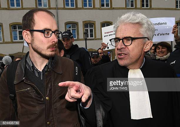 Former employee at services firm PwC Antoine Deltour speaks with his lawyer William Bourdon as he leaves the courthouse in Luxembourg on April 26...