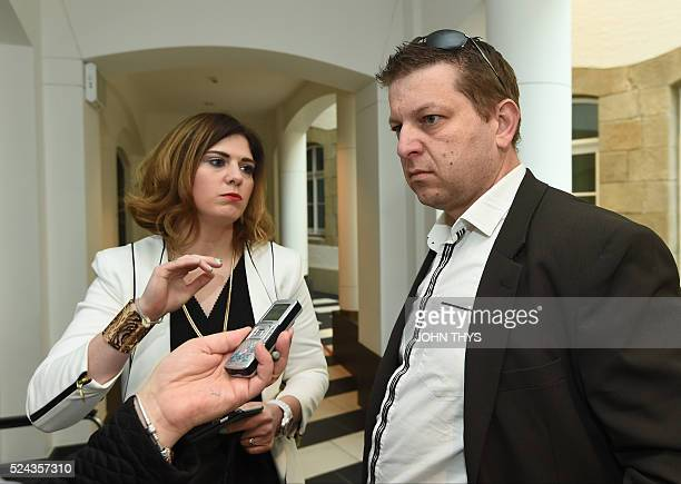 Former employee at services firm PwC Raphael Halet flanked by his lawyer May Nalepa answers journalists' questions at the courthouse in Luxembourg on...