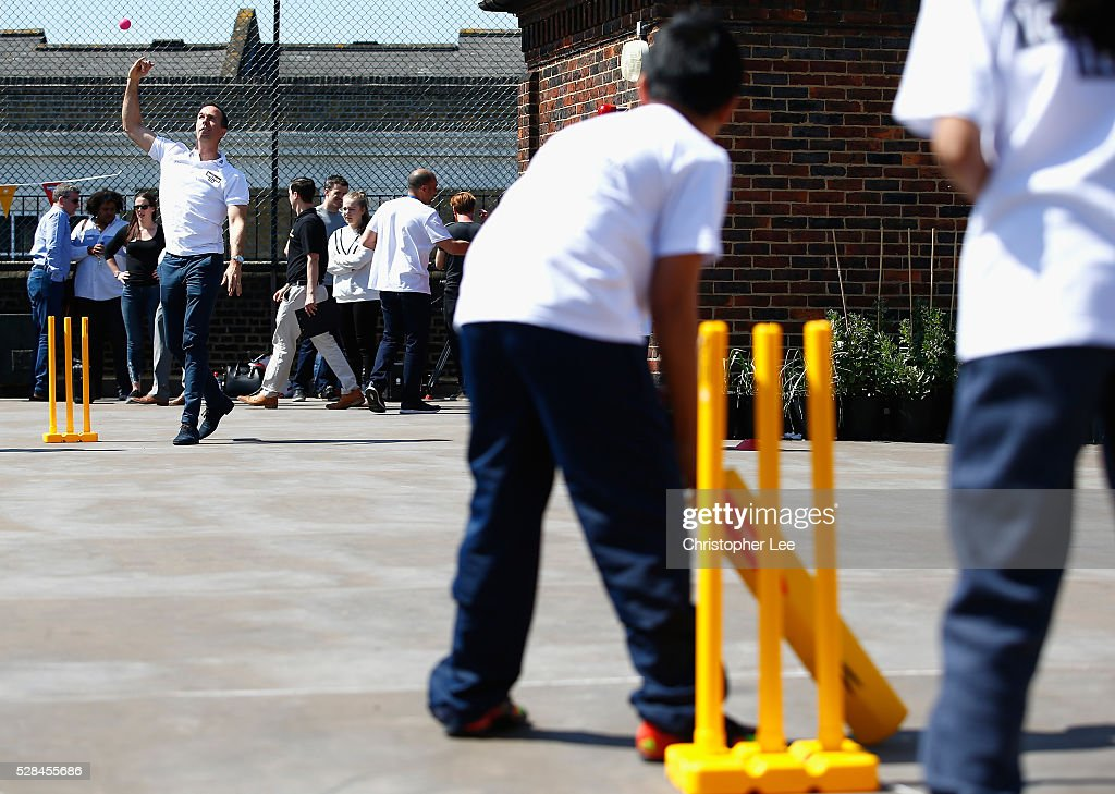 Former England and Lancashire Cricketer <a gi-track='captionPersonalityLinkClicked' href=/galleries/search?phrase=Michael+Vaughan&family=editorial&specificpeople=179446 ng-click='$event.stopPropagation()'>Michael Vaughan</a> bowls as he joins pupils of the Hague School for a game of cricket during the Launch of the Yorkshire Tea Cricket Commentator Search at The Hague Primary School on May 5, 2016 in London, England.