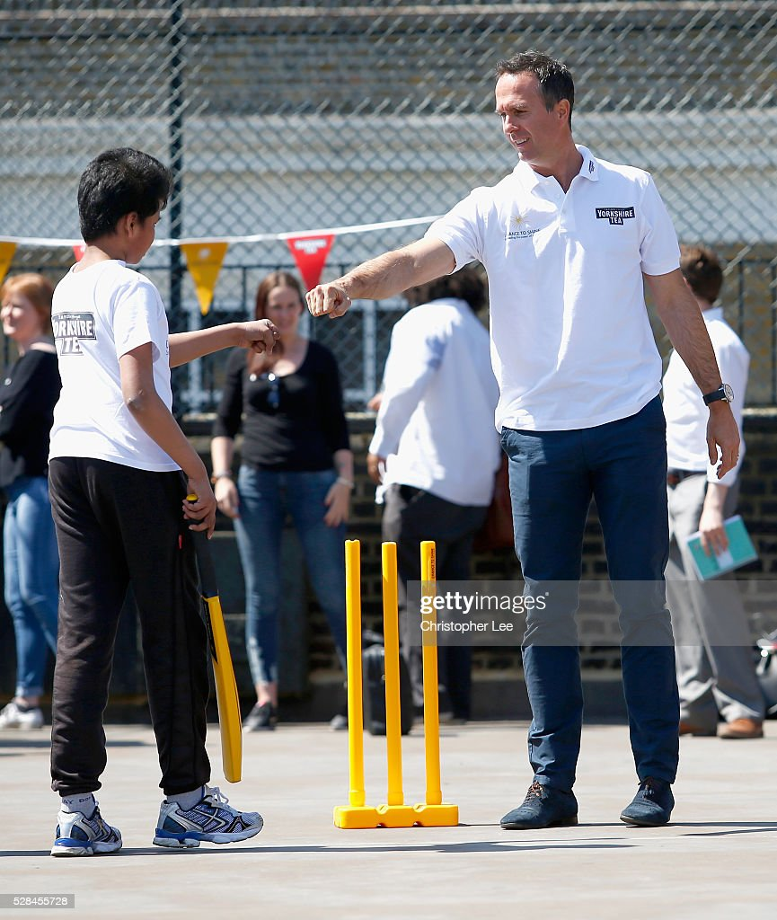 Former England and Lancashire Cricketer <a gi-track='captionPersonalityLinkClicked' href=/galleries/search?phrase=Michael+Vaughan&family=editorial&specificpeople=179446 ng-click='$event.stopPropagation()'>Michael Vaughan</a> his pumps a pupil as he congratulates him for a good shot as he joins pupils of the Hague School for a game of cricket during the Launch of the Yorkshire Tea Cricket Commentator Search at The Hague Primary School on May 5, 2016 in London, England.