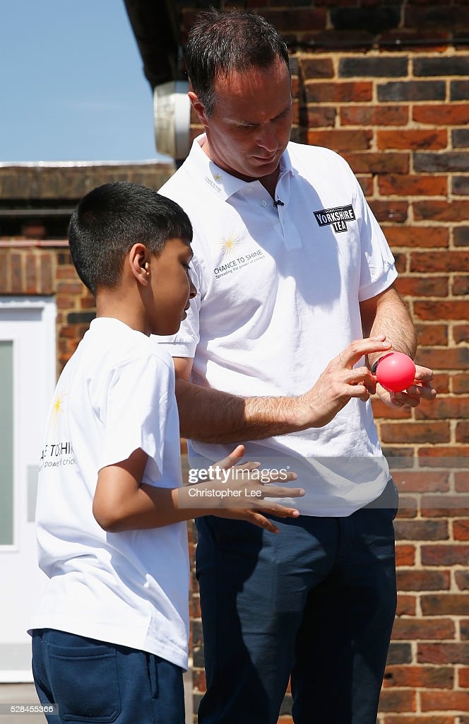 Former England and Lancashire Cricketer <a gi-track='captionPersonalityLinkClicked' href=/galleries/search?phrase=Michael+Vaughan&family=editorial&specificpeople=179446 ng-click='$event.stopPropagation()'>Michael Vaughan</a> teaches a young pupil how to bowl as he joins pupils of the Hague School for a game of cricket during the Launch of the Yorkshire Tea Cricket Commentator Search at The Hague Primary School on May 5, 2016 in London, England.