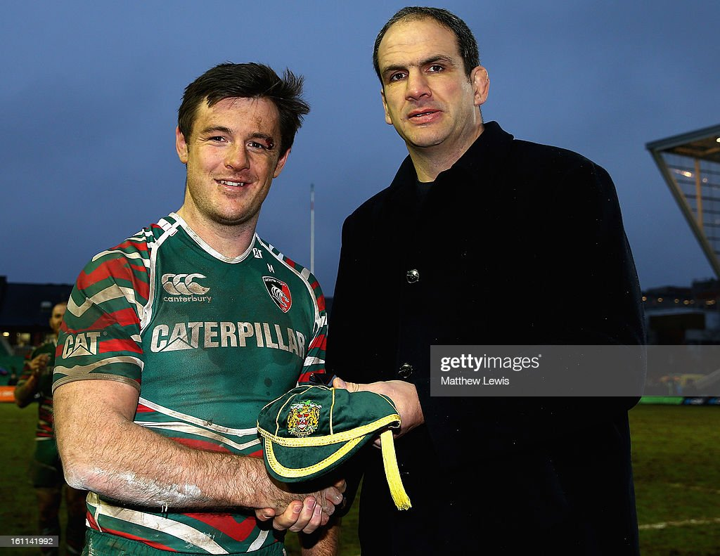 Former England and Leicester Tigers player <a gi-track='captionPersonalityLinkClicked' href=/galleries/search?phrase=Martin+Johnson+-+Rugby+Player&family=editorial&specificpeople=202978 ng-click='$event.stopPropagation()'>Martin Johnson</a> presents Matt Smith of Leicester Tigers with his 100th cap after the Aviva Premiership match between Leicester Tigers and London Welsh at Welford Road on February 9, 2013 in Leicester, England.