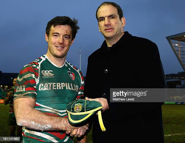 Former England and Leicester Tigers player Martin Johnson presents Matt Smith of Leicester Tigers with his 100th cap after the Aviva Premiership...