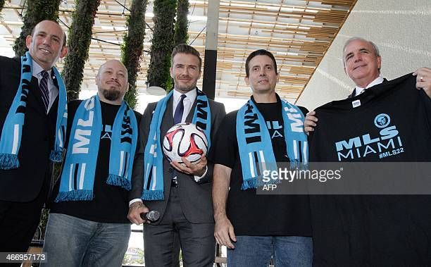Former England and Manchester United star David Beckham poses for photos after holding a press conference at the Perez Art Museum Miami in Miami...