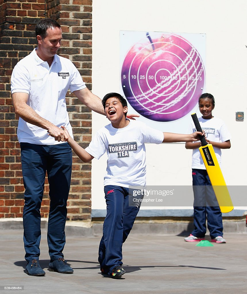 Former England and Yorkshire Cricketer <a gi-track='captionPersonalityLinkClicked' href=/galleries/search?phrase=Michael+Vaughan&family=editorial&specificpeople=179446 ng-click='$event.stopPropagation()'>Michael Vaughan</a> jokes with a pupil as he joins pupils of the Hague School for a game of cricket during the Launch of the Yorkshire Tea Cricket Commentator Search at The Hague Primary School on May 5, 2016 in London, England.