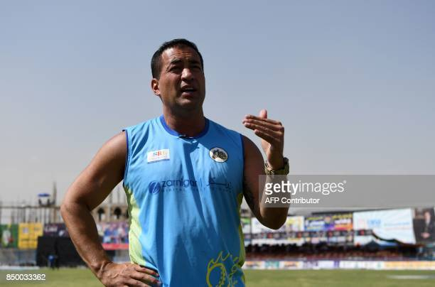 Former England captain Adam Hollioake who is coaching the Boost Defenders team in Afghanistan gestures as he speaks during an interview with AFP...