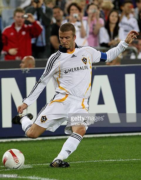 Former England captain David Beckham appearing as the captain of the US club LA Galaxy takes a corner kick during an exhibition match against Sydney...
