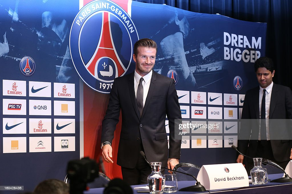 Former England captain David Beckham arrives with PSG's Qatari president Nasser Al-Khelaifi (R) to give a press conference at the Parc des Princes stadium in Paris, on January 31, 2013, to announce that he joined the French football club Paris Saint Germain (PSG).