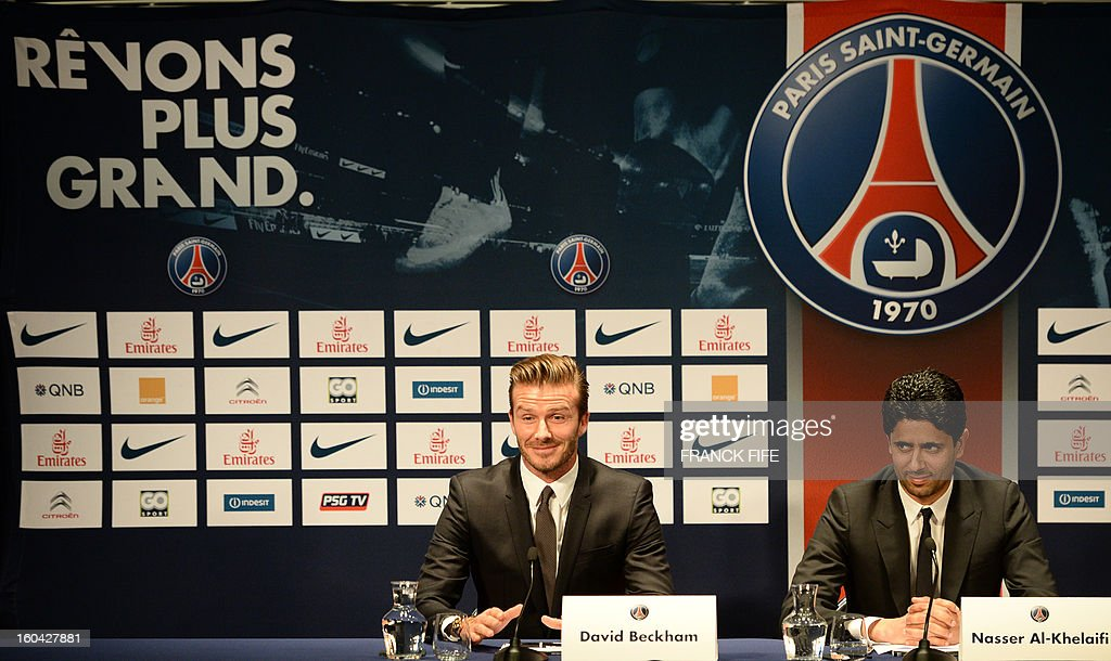 Former England captain David Beckham (L) gives a press conference flanked by PSG Qatari president Nasser Al-Khelaifi at the Parc des Princes stadium in Paris, on January 31, 2013, to announce that he joined the French football club Paris Saint-Germain (PSG).