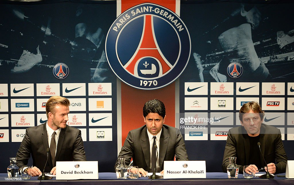 Former England captain David Beckham (L) gives a press conference flanked by PSG Qatari president Nasser Al-Khelaifi (C) and PSG sports director Leonardo at the Parc des Princes stadium in Paris, on January 31, 2013, to announce that he joined the French football club Paris Saint-Germain (PSG). AFP PHOTO / FRANCK FIFE