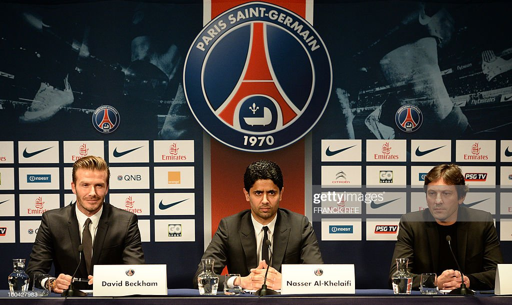 Former England captain David Beckham (L) gives a press conference with PSG's Qatari president Nasser Al-Khelaifi (C) and PSG's sports director Leonardo at the Parc des Princes stadium in Paris, on January 31, 2013. Beckham on January 31 signed a five-month deal with the Ligue 1 leaders until the end of June.