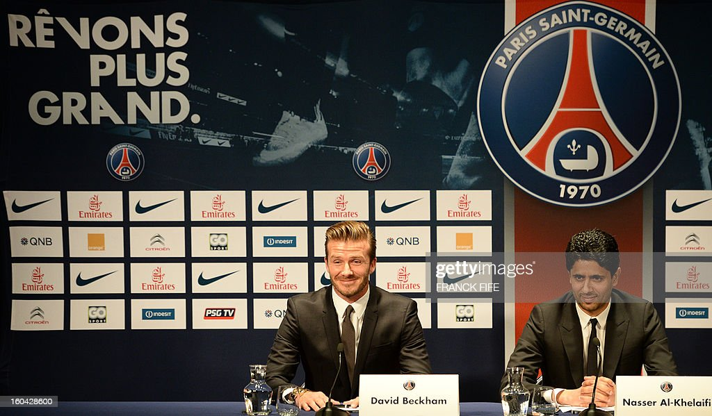 Former England captain David Beckham (C) gives a press conference with PSG's Qatari president Nasser Al-Khelaifi (R) at the Parc des Princes stadium in Paris, on January 31, 2013. Beckham on January 31 signed a five-month deal with the Ligue 1 leaders until the end of June. AFP PHOTO / FRANCK FIFE