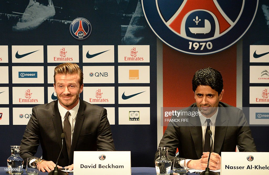 Former England captain David Beckham (C) gives a press conference with PSG's Qatari president Nasser Al-Khelaifi (R) at the Parc des Princes stadium in Paris, on January 31, 2013. Beckham on January 31 signed a five-month deal with the Ligue 1 leaders until the end of June.