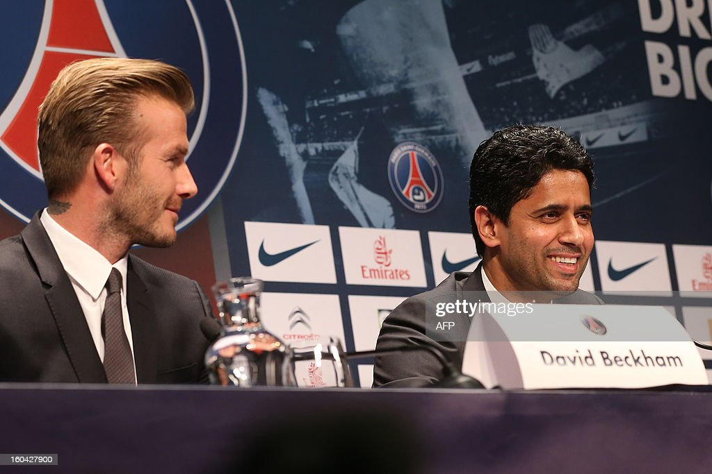 Former England captain David Beckham (L) looks at Paris Saint-Germain SG's Qatari president Nasser Al-Khelaifi during a press conference at the Parc des Princes stadium in Paris on January 31, 2013. Beckham on January 31 signed a five-month deal with the Ligue 1 leaders until the end of June. SAMSON