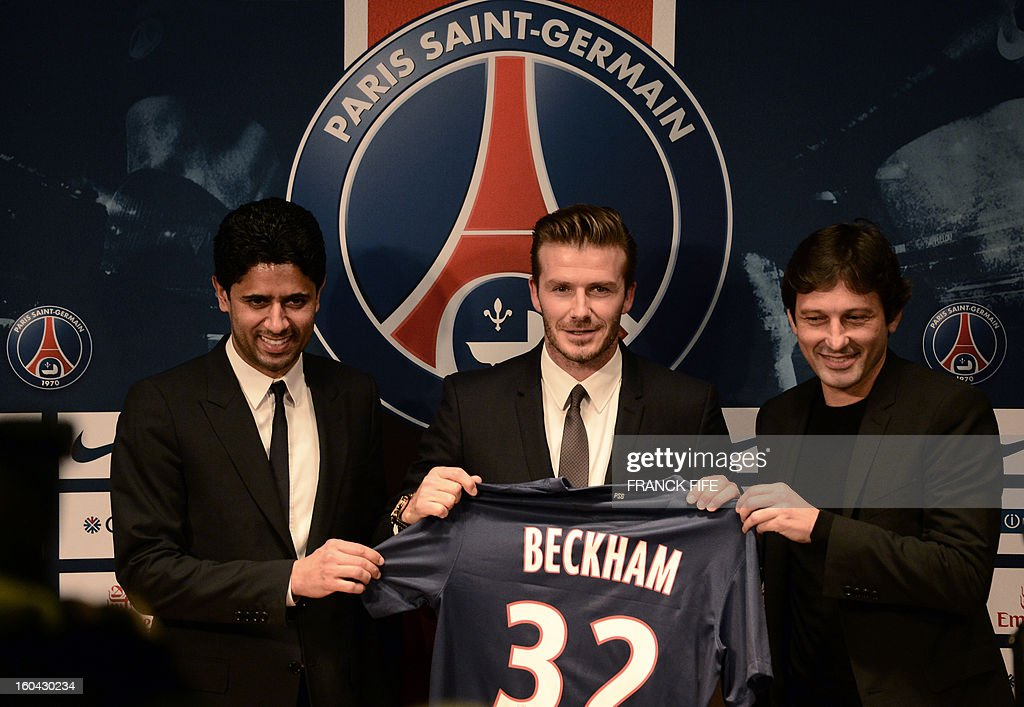 Former England captain David Beckham (C) poses with his new jersey as he gives a press conference flanked by PSG Qatari president Nasser Al-Khelaifi (L) and PSG sports director Leonardo at the Parc des Princes stadium in Paris, on January 31, 2013, to announce that he joined the French football club Paris Saint-Germain (PSG).