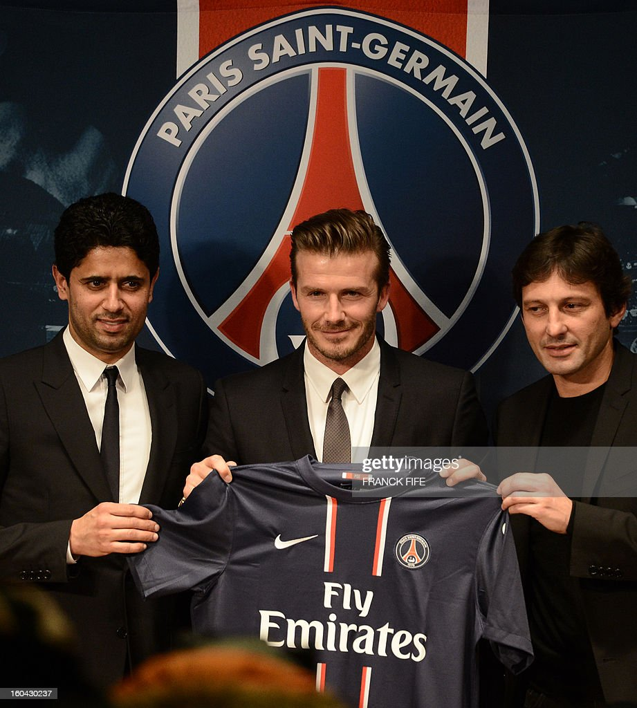 Former England captain David Beckham (C) poses with his new jersey as he gives a press conference flanked by PSG Qatari president Nasser Al-Khelaifi (L) and PSG sports director Leonardo at the Parc des Princes stadium in Paris, on January 31, 2013. Beckham on January 31 signed a five-month deal with the Ligue 1 leaders until the end of June.AFP PHOTO / FRANCK FIFE