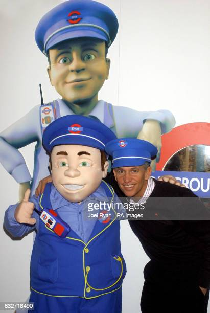 Former England captain Gary Lineker appears with a lifesize version of cartoon character Underground Ernie on the opening day of the toy fair at the...