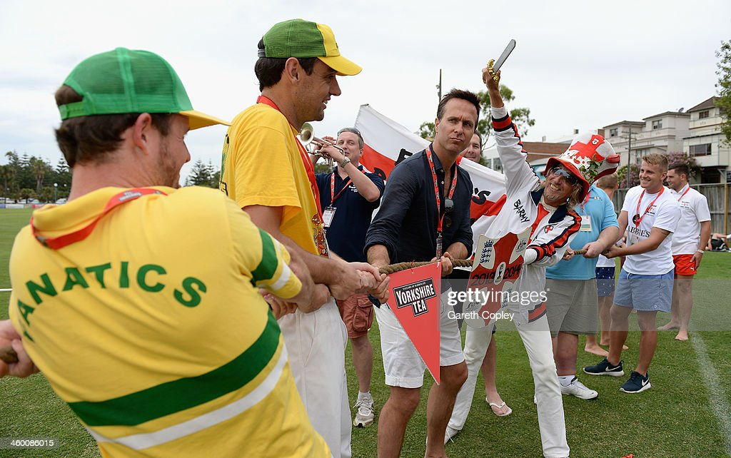 Former England captain <a gi-track='captionPersonalityLinkClicked' href=/galleries/search?phrase=Michael+Vaughan&family=editorial&specificpeople=179446 ng-click='$event.stopPropagation()'>Michael Vaughan</a> referees a tug of war between England and Australian cricket fans during the Yorkshire Tea Beach Party at Coogee Beach on January 2, 2014 in Sydney, Australia.