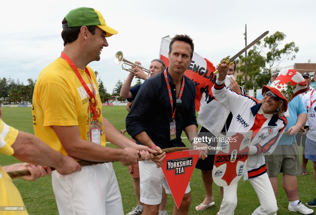 Former England captain Michael Vaughan referees a tug of war between England and Australian cricket fans during the Yorkshire Tea Beach Party at...