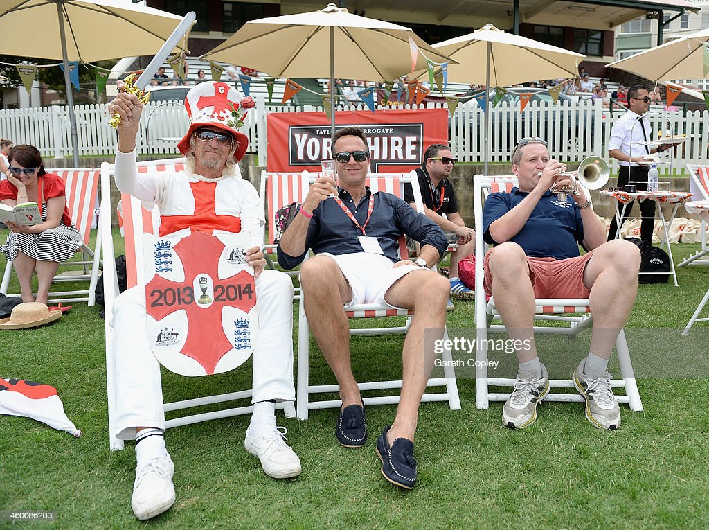 Former England captain <a gi-track='captionPersonalityLinkClicked' href=/galleries/search?phrase=Michael+Vaughan&family=editorial&specificpeople=179446 ng-click='$event.stopPropagation()'>Michael Vaughan</a> relaxes with England fans Vic Flowers and Billy Cooper during the Yorkshire Tea Beach Party at Coogee Beach on January 2, 2014 in Sydney, Australia.