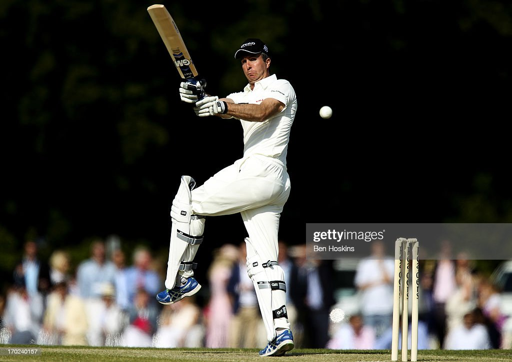 Former England Captain Michael Vaughn hits out during Shane Warne's Australia vs Michael Vaughan's England T20 match at Cirencester Cricket Club on June 09, 2013 in Cirencester, England.